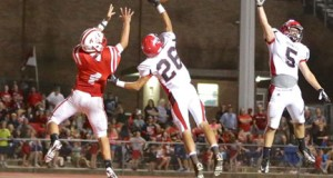 Hilldale's Matt Bargsten (26) and Dylan Duncan (5) defend a pass against Fort Gibson in 2013.  Photo courtesy Hilldale Athletic Dept.