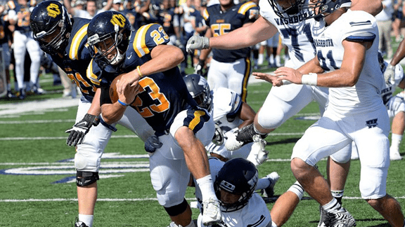 Central's Clay McKenzie rushes for a touchdown against Washburn. Photo courtesy UCO Photo Services.