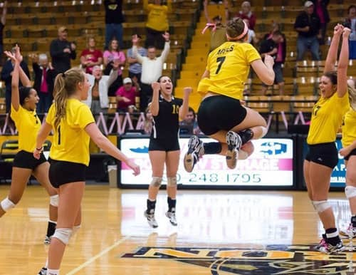 The Cameron volleyball team celebrates its win over Texas A&M-Kingsville in the LSC Tournament. Photo courtesy CU Sports Info.