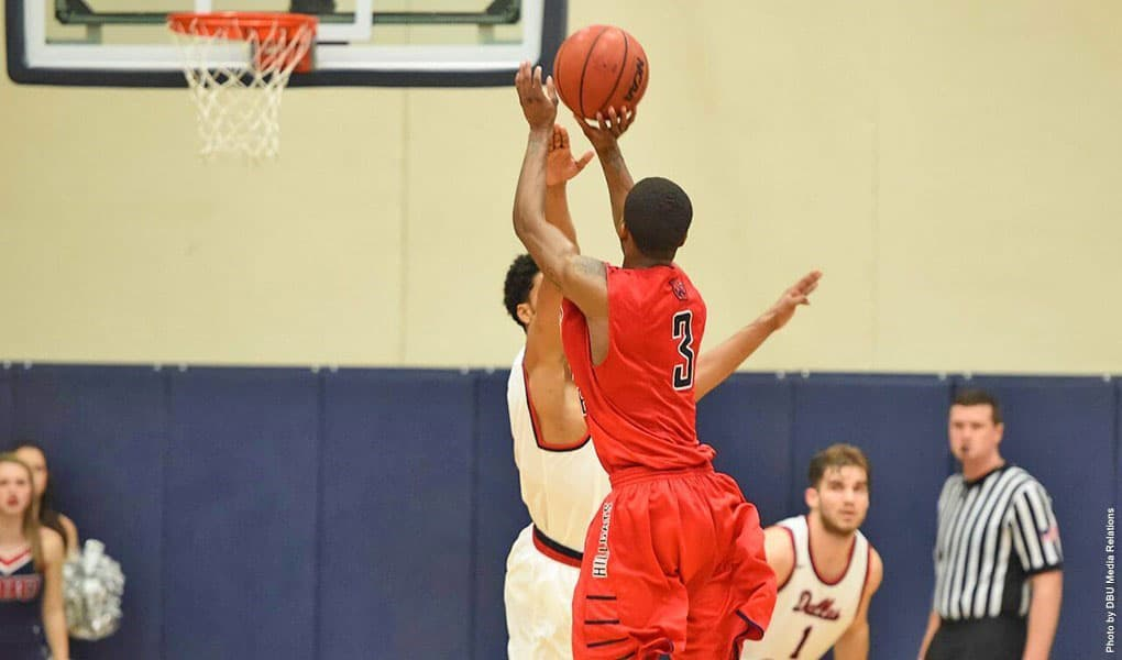 Rogers State's Donald Moore puts up the winning shot at Dallas Baptist to help the Hillcats earn the Heartland Conference championship. Photo courtesy RSU Sports Info.