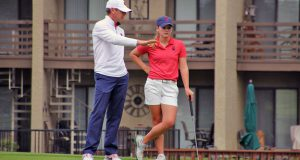 Rogers State golf coach Josh Fosdick speaks with Stirling Phillips. Photo courtesy RSU Sports Info.