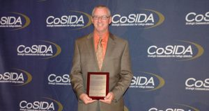 Assistant Athletic Director for Media Relations for Central Oklahoma, Mike Kirk receives an honor 25 years with CoSIDA. Photo courtesy UCO Sports Info.