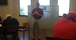 OU Associate A.D. Kenny Mossman addresses FCA coaches in Durant. Staff photo.