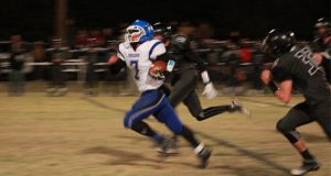 CBA quarterback Dylan Schimdt escapes down the middle of the field. Photo credit: Wesley Javorsky.