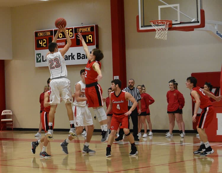 Conner Brister (23) hits a jumper. Photo by Vicki Droddy.
